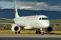 Air Canada Embraer 190 taxies in the evening sun