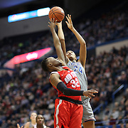 HARTFORD, CONNECTICUT- DECEMBER 19: Napheesa Collier #24 of the Connecticut Huskies is fouled by Shayla Cooper #32 of the Ohio State Buckeyes during the UConn Huskies Vs Ohio State Buckeyes, NCAA Women's Basketball game on December 19th, 2016 at the XL Center, Hartford, Connecticut (Photo by Tim Clayton/Corbis via Getty Images)