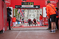Nathan Maguire crosses the line to win the Boys u17 Wheelchair Race in the Virgin Giving Mini London Marathon, Sunday 26th April 2015.<br /> <br /> Scott Heavey for Virgin Money London Marathon<br /> <br /> For more information please contact Penny Dain at pennyd@london-marathon.co.uk