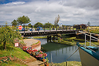 Swing Bridge on The River Hull near to the village, with many house boats  and bridge keepers cottage.