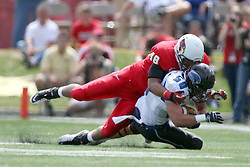 15 September 2012:  Adam Gristick comes to the ground compliments of Jordan Neukirch during an NCAA football game between the Eastern Illinois Panthers and the Illinois State Redbirds at Hancock Stadium in Normal IL