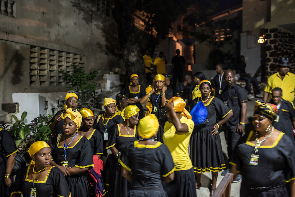 Members of the Societe Ti Pilon Baka vodou troupe prepare for a ceremony on Sunday, December 14, 2014 in Port-au-Prince, Haiti.