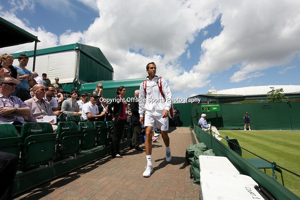 30/06/2012 - Wimbledon (Day 6) - Philipp KOHLSCHREIBER (GER) vs. Lukas ROSOL (CZE) - Lukas Rosol arrives on Court 12 for his match - Photo: Simon Stacpoole / Offside.