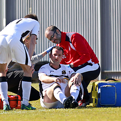 Garry Fleming takes a sore one  during the Dumbarton v Falkirk Scottish Championship 06 May 2017<br /> <br /> <br /> <br /> <br /> <br /> (c) Andy Scott | SportPix.org.uk
