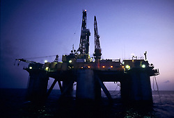 Stock photo of a semi-submersible rig at dusk