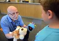 "Volunteer, and Penn Memory Center patient Leslie Wolff (left) entertains Jacob Taylor, 9, with his puppets Tuesday, September 05, 2017 at CHOP Care Network in Philadelphia, Pennsylvania. The Penn Memory Center, which serves people with dementia mild cognitive disorder, has a new volunteer partnership with CHOP. Its patients and ""normal controls"" volunteer with CHOP patients. (WILLIAM THOMAS CAIN / For The Philadelphia Inquirer)"