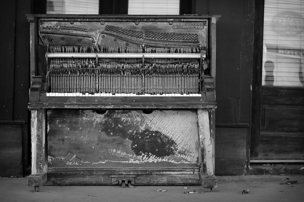 A lone piano left outside of a flooded bar after Hurricane Ike in Galveston, Texas.
