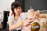 Woman working on dressmaker's dummy