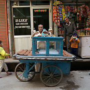 A street hawker selling Phirni out of a 'cold box' on a cart on the streets of Amritzar, March 2007