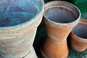 Clay pottery. High angle of three clay pots standing side by side.