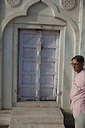 Brij Khandelwal, a renown environmental journalist for the Times of India, is inspecting the damage and writing on a door inside the Taj Mahal complex.