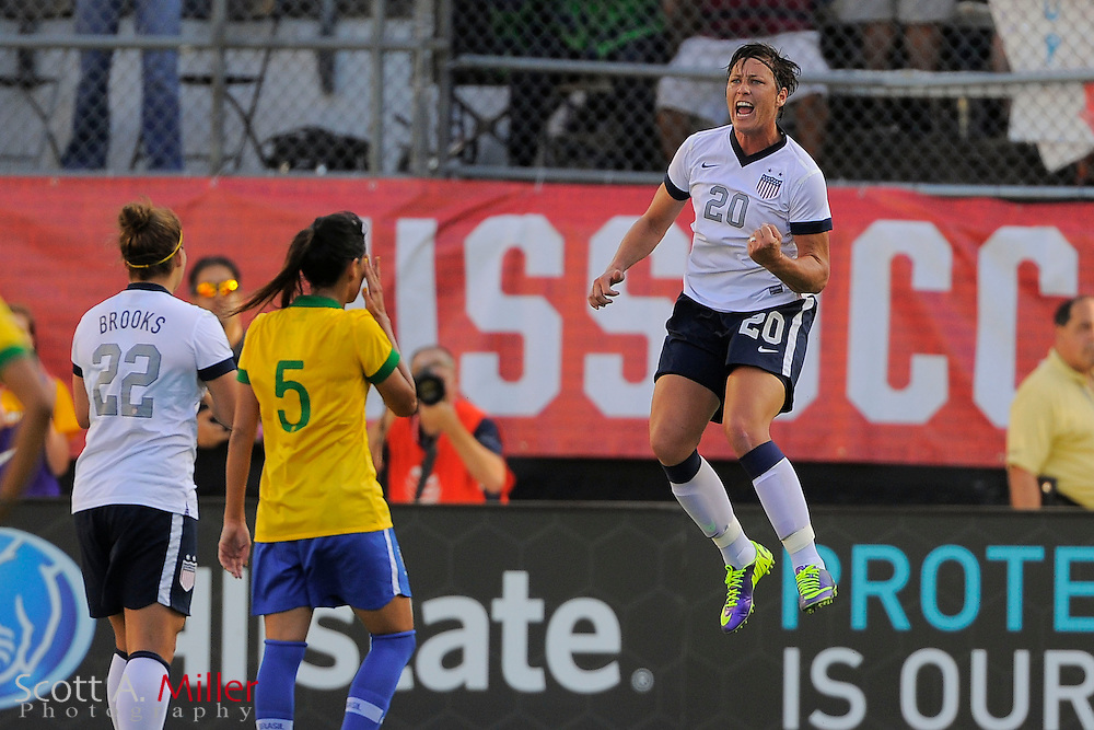 U.S. forward Abby Wambach (20) celebrates scoring on a penalty kick during the first half of  an international friendly against Brazil at the Florida Citrus Bowl on November 10, 2013  in Orlando, Florida.      ©2013 Scott A. Miller