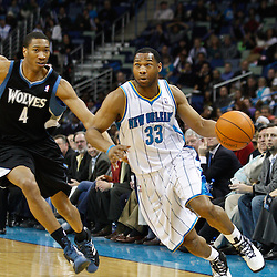 February 7, 2011; New Orleans, LA, USA; New Orleans Hornets shooting guard Willie Green (33) drives past Minnesota Timberwolves small forward Wesley Johnson (4) during the first quarter at the New Orleans Arena.   Mandatory Credit: Derick E. Hingle