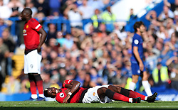 Manchester United's Paul Pogba lies injured on the pitch after being tackled by Chelsea's Antonio Rudiger (not in frame)
