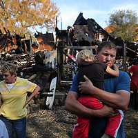 Tony Mork holds his daughter, Sienna, after an early-morning fire destroyed their home in Tea, S.D. The family of four and two overnight guests escaped uninjured from the home at 135 N. Cole Ave. after smoke alarms went off about 5:45 a.m.