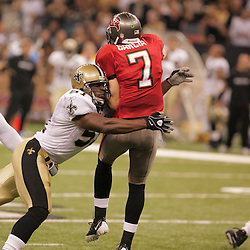 2008 September 7: New Orleans Saints linebacker Jonathan Vilma (51) hits Tampa Bay Buccaneers quarterback Jeff Garcia (7) as he passes the ball during their game at the Louisiana Superdome in New Orleans, LA.