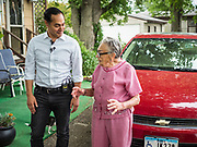 14 JUNE 2019 - WAUKEE, IOWA: JULIÁN CASTRO, left, Democratic presidential candidate and former Secretary of Housing and Urban Development during the Obama administration, talks to ARLETA SWAIN, 92 years old, a resident of Midwest County Estates, a mobile home community in Waukee, a suburb of Des Moines, Friday. Castro met with residents in the community to talk about affordable housing. Mobile County Estates was sold in March and the new owners are trying to hike rents for lots in the community by 69%, an amount residents say they can't afford. Swain was one of the first people to move into Midwest County Estates. She's been living in the mobile home park since it opened in 1969. Castro is visiting Iowa to support his candidacy for the Democratic ticket of the US Presidency. Iowa traditionally hosts the the first selection event of the presidential election cycle. The Iowa Caucuses will be on Feb. 3, 2020.                                  PHOTO BY JACK KURTZ