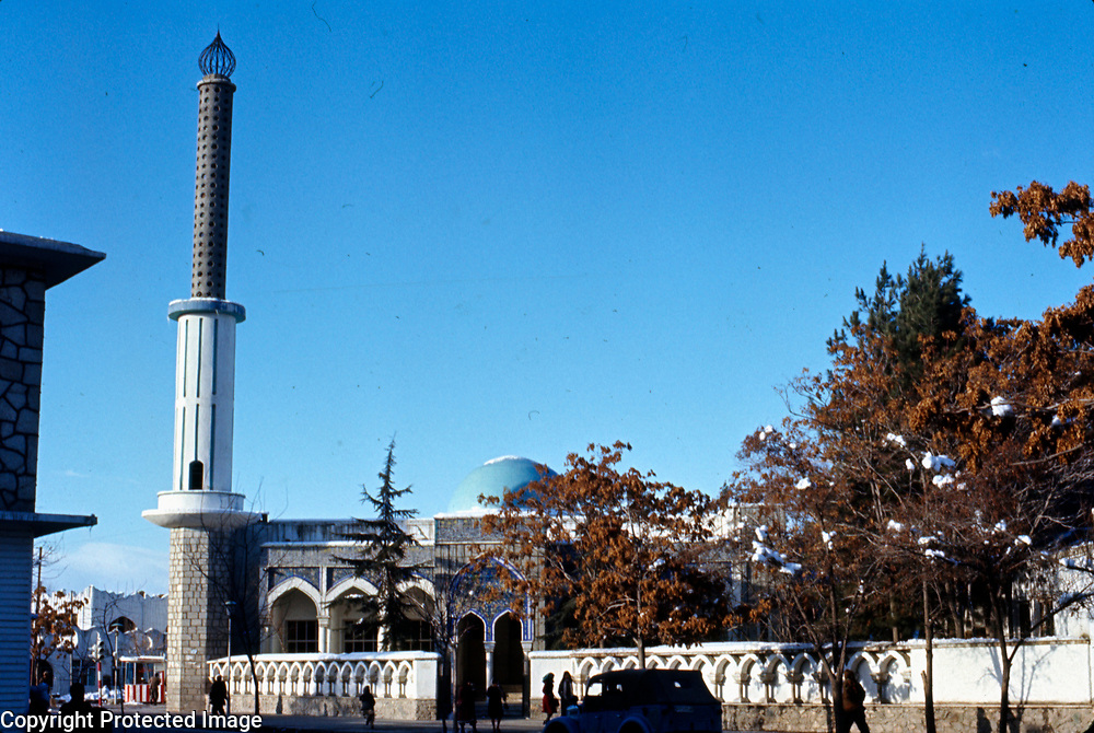 January 1977<br /> The Sherpur mosque, also known as the Blue Mosque, is the western anchor of the Shahr-i-Naw, Shopping area. Built in 1957 by the Kabul Municipality, it sits beside the site of a smaller, older mosque established by Haji Yaqub, a neighborhood resident. Although highly respected, just who the good Haji was is uncertain.