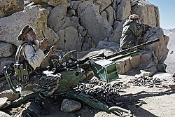20010926-SALANG, AFGHANISTAN: The fighters of anti-Taliban opposition shell the Taliban position on the pass Salang, 26 September, 2001.
