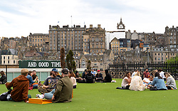 Edinburgh, Scotland, UK. 12 July, 2020, Business slowly returning to normal in Edinburgh city centre. Tourists still almost non existent and streets remain very quiet in the Old Town. Outdoor seating on Princes Street at Neighbourhood beer garden . Iain Masterton/Alamy Live News