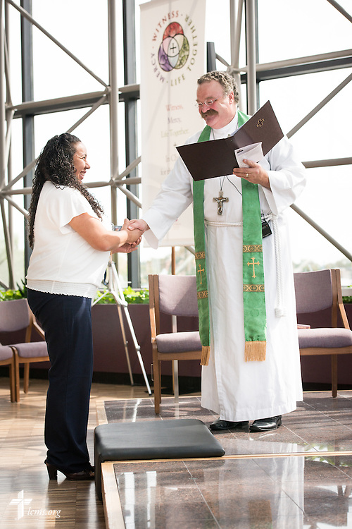 The Rev. Dr. Matthew C. Harrison, president of The Lutheran Church–Missouri Synod, installs Deaconess Mireya Johnson, production coordinator in LCMS Communications, in the International Center chapel of The Lutheran Church–Missouri Synod on Wednesday, Sept. 3, 2014, in Kirkwood, Mo. LCMS Communications/Erik M. Lunsford