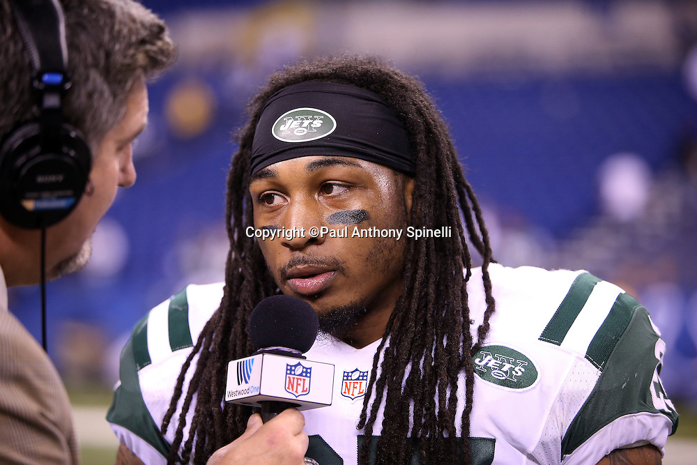 New York Jets free safety Calvin Pryor (25) does a postgame radio interview after the 2015 NFL week 2 regular season football game against the Indianapolis Colts on Monday, Sept. 21, 2015 in Indianapolis. The Jets won the game 20-7. (©Paul Anthony Spinelli)