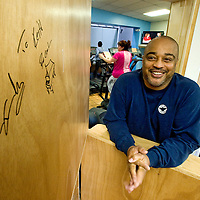 010212       Adron Gardner<br /> <br /> Gallup Fitness Center General Manager Kieth Money stands by a signature left by hip hop artist R. Kelly at the Fitness Center Wednesday.