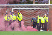 Stewards deal with a smoke grenade thrown from the Hearts end during the Ladbrokes Scottish Premiership match between Kilmarnock FC and Heart of Midlothian FC at Rugby Park, Kilmarnock, Scotland on 23 November 2019.
