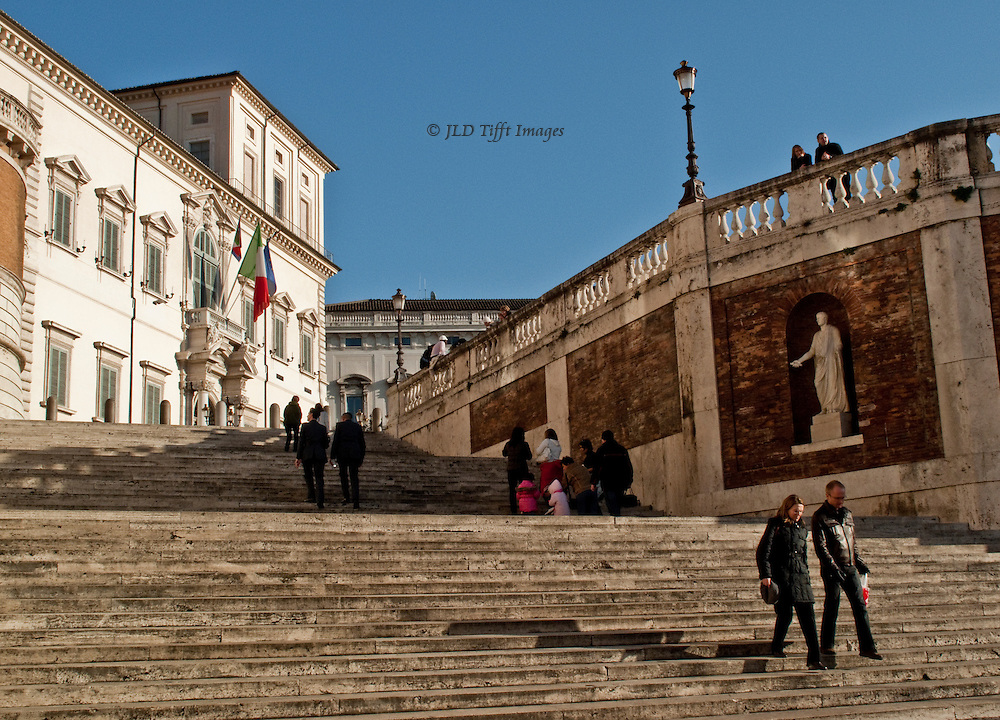 A young couple descending the long staircase up the Quirinal hill, Rome, toward the Quirinal Palace, seat of government.