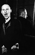 A Skinhead, gesturing to camera, Electric Ballroom, Candem, London, UK, 1980's