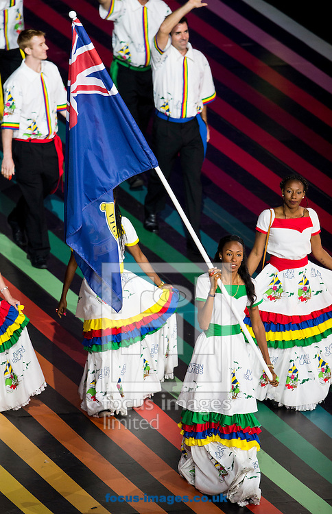Chantel Malone ( bottom centre) of the British Virgin Islands carries the flag as she leads the team during the Glasgow 2014 Commonwealth Games Opening Ceremony at Celtic Park, Glasgow<br /> Picture by Paul Terry/Focus Images Ltd +44 7545 642257<br /> 23/07/2014