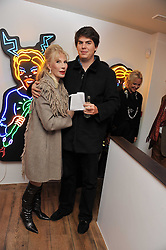 DONATELLA FLICK and her son SEBASTIAN FLICK at a private view of Amanda Eliasch's work  'Peccadilloes' held at Doyle Devere Gallery, 30 Ledbury Road, London W11 on 3rd November 2011.