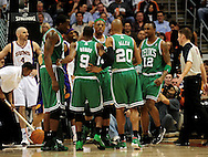 Jan. 28, 2011; Phoenix, AZ, USA; Boston Celtics teammates Kendrick Perkins (34) , Rajon Rondo (9) , Ray Allen (20) , Von Wafer (12) , and Paul Pierce (34)  react on the court against the Phoenix Suns at the US Airways Center.  The Suns defeated the Celtics 88-71. Mandatory Credit: Jennifer Stewart-US PRESSWIRE