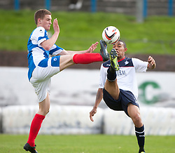 Cowdenbeath's Thomas O'Brien and Falkirk's Phil Roberts.<br /> Half time; Cowdenbeath v Falkirk, 14/9/2013.<br /> &copy;Michael Schofield.