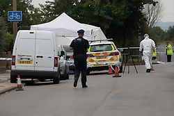 © Licensed to London News Pictures. 01/07/2017. GRAYS, Essex, UK.  Police officer and forensice officer at the police cordon at Blackshots Lane in Grays, Essex. A man has died and three others have life threatening injuries following a street fight in Blackshots Lane, Grays, Essex last night.  Photo credit: Vickie Flores/LNP