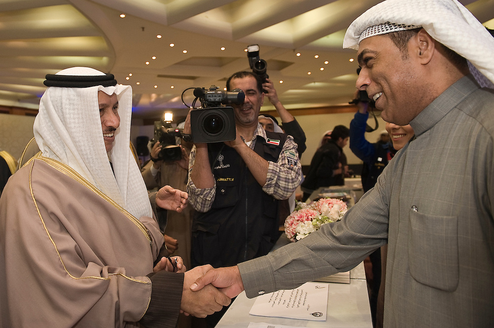 His Highness Sheikh Jaber Mubarak Al-Sabah, the Prime Minister, being greeted by a Ministry of Information official at the ministry's information booth inside the elections media center on Jan. 25 in Kuwait City. Some 320 candidates are running in the February 2 elections to elect a new 50-member National Assembly (parliament).