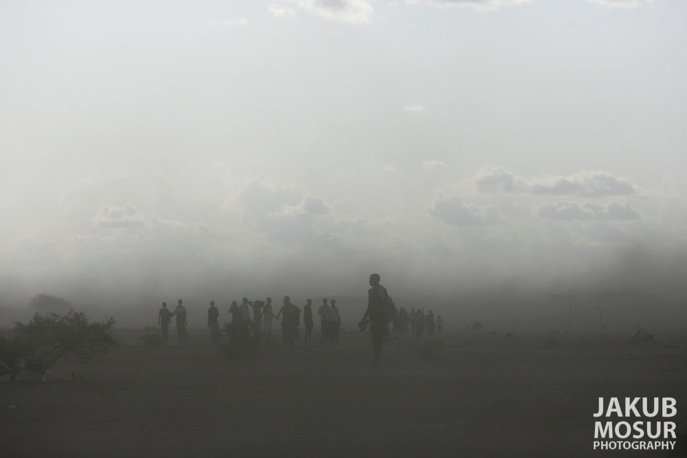 September 14, 2006 - Somali youths walk through a sand storm in Dadaab, Kenya, 50 miles from the Somali border. Somalis are fleeing from recent clashes between Somalia Union of Islamic Courts and Somali warlords. Over 21,000 refugees since January 2006 have arrived in Dadaab which has a growing population of 140,000 refugees, in the North Eastern province of Kenya..(Photo by Jakub Mosur/Polaris)