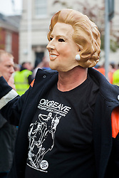 "Rotherham England<br /> 13 September 2014 <br /> A protester wearing a Margaret Thatcher Mask and ORGREAVE Truth And Justice Campaign T-Shirt Joins EDL supporters outside outside Rotherham Town Hall before the march to Rotherham Main Street Police station as part of the English Defence Leagues ""Justice for the Rotherham 1400"" March described by an EDL Facebook Page as ""a protest against the Pakistani Muslim grooming gangs"" on Saturday Afternoon <br /> <br /> <br /> Image © Paul David Drabble <br /> www.pauldaviddrabble.co.uk"