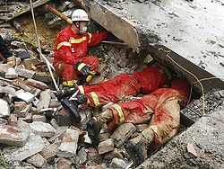 Aug. 14, 2017  Mabu, China - Rescuers search for the missing people in Mabu village, Rong'an County, south China's Guangxi Zhuang Autonomous Region. Three people were missing after torrential rain swept parts of the region, resulting in disasters including floods and landslides.  (Credit Image: © Li Ruihua/Xinhua via ZUMA Wire)