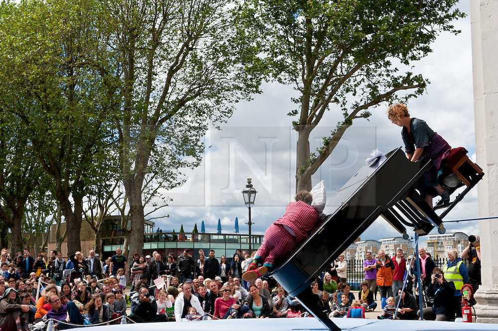© Licensed to London News Pictures. 24/06/2012. London, UK.  Carrousel des Moutons, a circus performance act, perform at the Greenwich Fair.  Greenwich Fair is a part of the Greenwich & Docklands International Festival, taking place between 21-30 June.  Photo credit : Richard Isaac/LNP