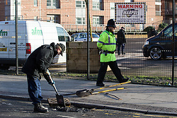 © Licensed to London News Pictures . 04/01/2015 . Manchester , UK . Police search drains on Charles Street , central Manchester , where a 26-year-old man was found fatally stabbed in the early hours of this morning (4th January 2014) . Police report being called to the scene by an ambulance crew , where they found a crowd of people on the street following a fight that spilled from a nearby club on to the street . Photo credit : Joel Goodman/LNP