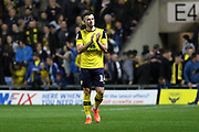 Anthony Forde (14) of Oxford United congratulating fans  after the EFL Cup match between Oxford United and West Ham United at the Kassam Stadium, Oxford, England on 25 September 2019.