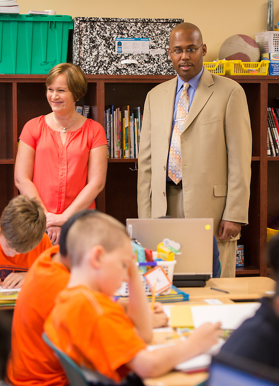 Chief Human Resources Officer Dr. Rodney Watson visits principal Susan Shenker and classrooms at Walnut Bend Elementary School, October 4, 2013.