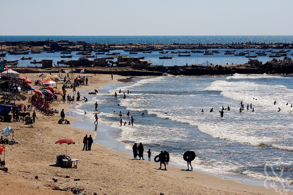 A crowd of Palestinians enjoy the beach August 06, 2007 in Gaza City, gaza. Palestinians, citing the increased climate of security have been flocking to beaches since Hamas took control of Gaza in June, something many say they had not been able to do for years...