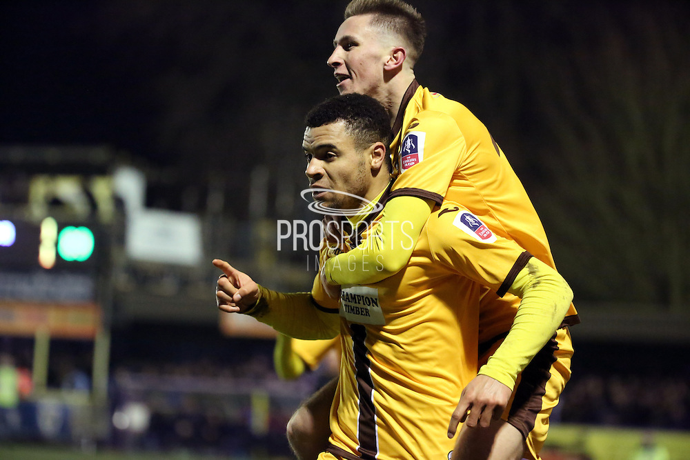 Sutton United striker Maxime Biamou (24) celebrating scoring 1-2 during the The FA Cup third round replay match between AFC Wimbledon and Sutton United at the Cherry Red Records Stadium, Kingston, England on 17 January 2017. Photo by Matthew Redman.