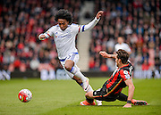 Chelsea Midfielder Willian (22) skips away from Bournemouth Defender Charlie Daniels (11) tackle during the Barclays Premier League match between Bournemouth and Chelsea at the Goldsands Stadium, Bournemouth, England on 23 April 2016. Photo by Adam Rivers.