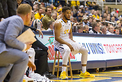 West Virginia Mountaineers guard Gary Browne (14) sits on a stool against the Texas Longhorns during the second half at the WVU Coliseum.