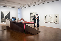 "© Licensed to London News Pictures. 28/11/2019. LONDON, UK. A general view of exhibition space, including the installation ""Geburtenbett"", 1980, at the preview of ""The 1980 Venice Biennale Works"" by Austrian artist Valie Export at Galerie Thaddeus Ropac in Mayfair.  The exhibition comprises innovative multimedia installation from the 39th Venice Biennale and 17 large-scale photographs mounted on wooden panels from her important photographic series Body Configurations (1972–82).  The show runs 28 November to 25 January 2020.  Photo credit: Stephen Chung/LNP"