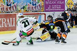 Tomi Mustonen (HDD Tilia Olimpija, #21) shots wide of the goal during ice-hockey match between HDD Tilia Olimpija and Moser Medical Graz 99ers in 2nd Round of EBEL league, on September 15, 2011 at Hala Tivoli, Ljubljana, Slovenia. (Photo By Matic Klansek Velej / Sportida)