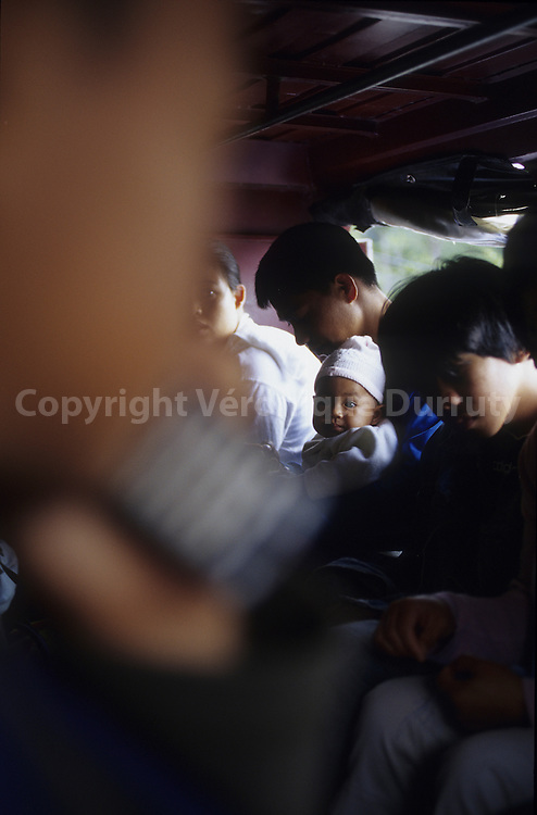 INSIDE AN OVERLOADED JEEPNEY, LUZON ISLAND, THE PHILIPPINES